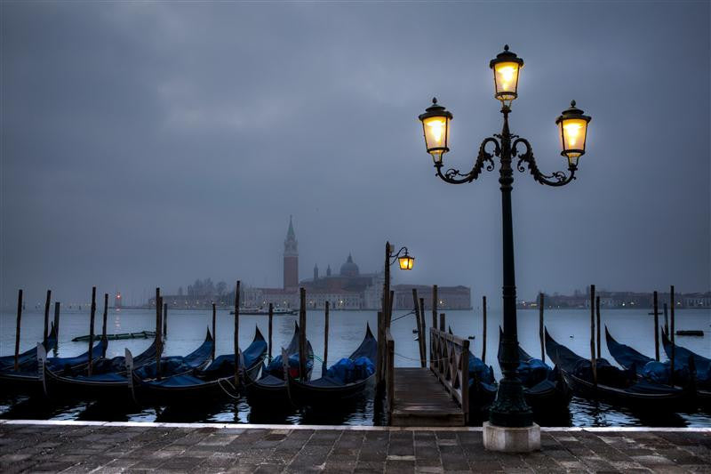 Photograph of many gondolas waiting to be used in Venice
