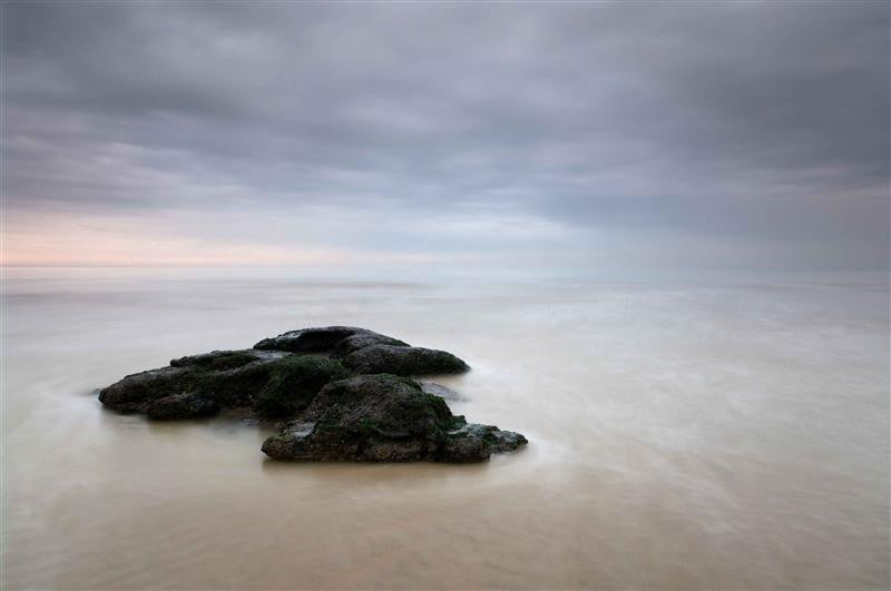 A calm photograph of Winchelsea Beach at dusk as the tide comes in