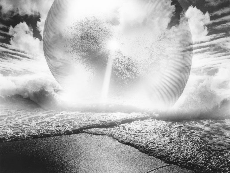 Surreal photograph of a shell landing on a beach in black and white
