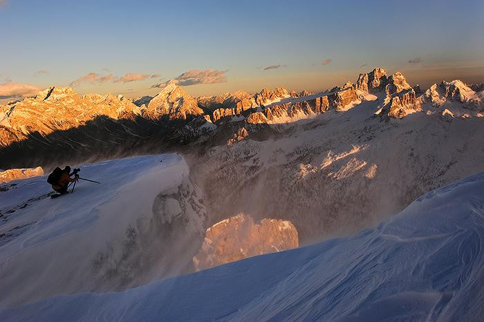 Sun drenched photograph of the Dolomites as the sun rises early in the morning