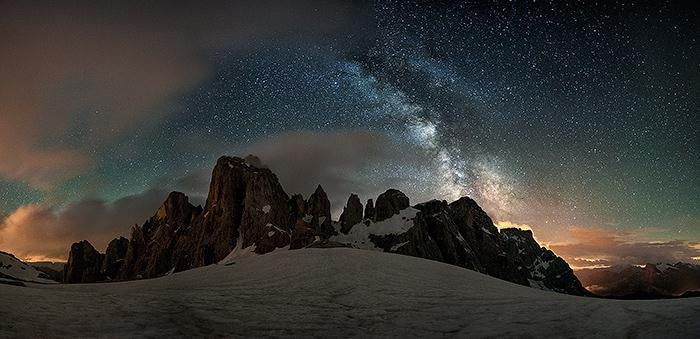 Long exposure photography of the Milky Way with the Dolomites in Italy