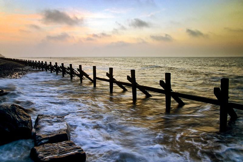 Seascape photograph of the setting sun at West Runton