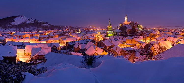 Night photograph of a small town covered in snow in winter