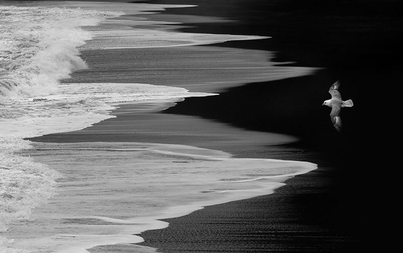 Abstract photograph of a beach as the tide slowly closes in