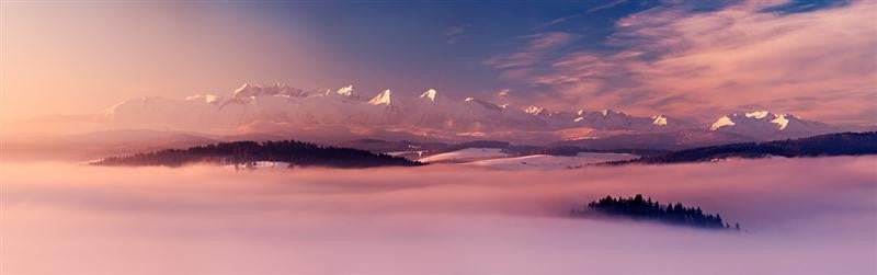Stunning panoramic overlooking the mountains covered in mist