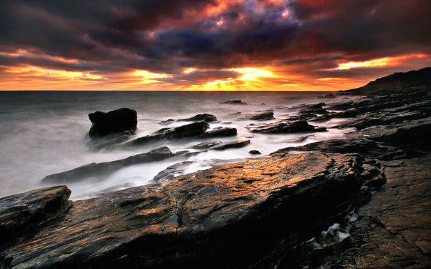 Long exposure photography of a sunset on a rugged coat in Ireland
