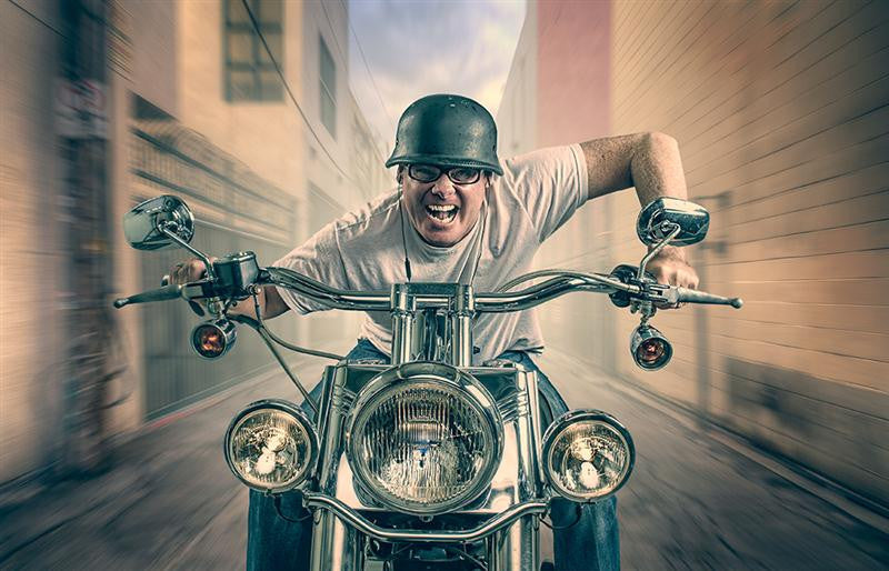 Surreal digital art of a mad man riding his bike towards the artist