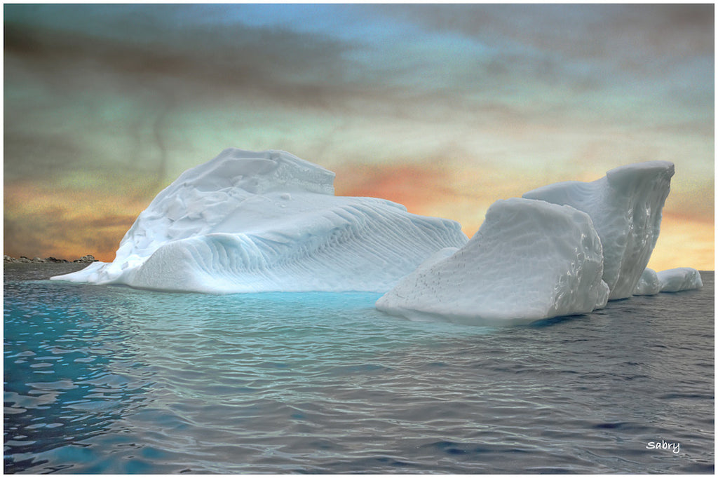 Photograph of a melting Iceberg floating across the sea