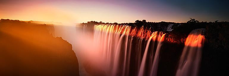 Beautiful sunset of a waterfall on the Zambezi River using long exposure photography