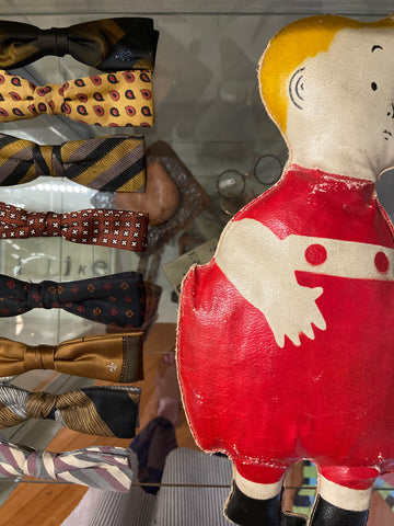 Vintage bowties and oilcloth doll