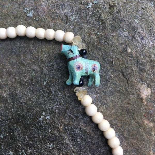 S194 - Carved Animals Necklace