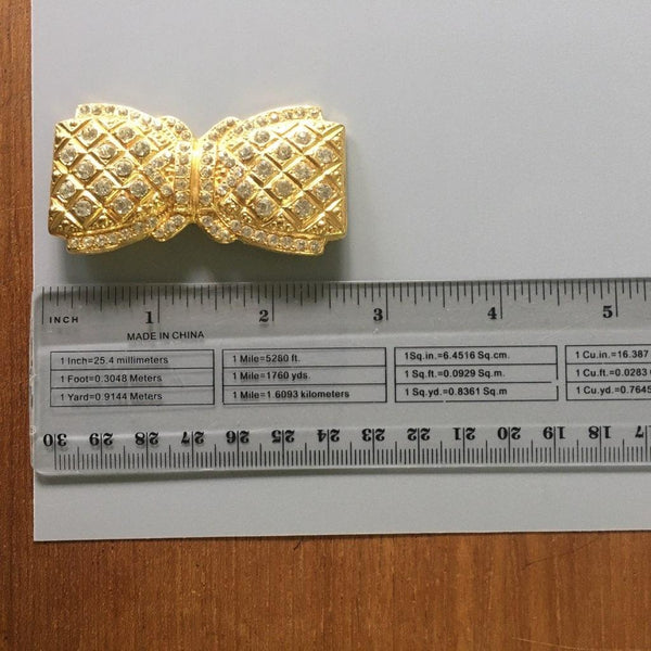 T147 - Rhinestone Bow Pin in Goldtone