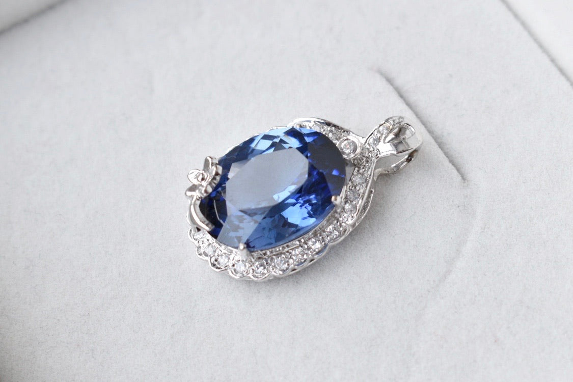 Lab Grown Oval Blue Sapphire and Moissanite Halo Pendant in 10K White Gold