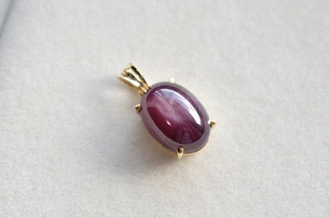 Natural Star Ruby Oval Cabochon Pendant in 14K Yellow Gold