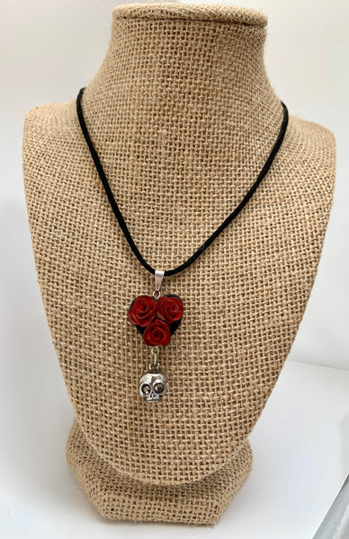 Crimson roses with skull heart necklace