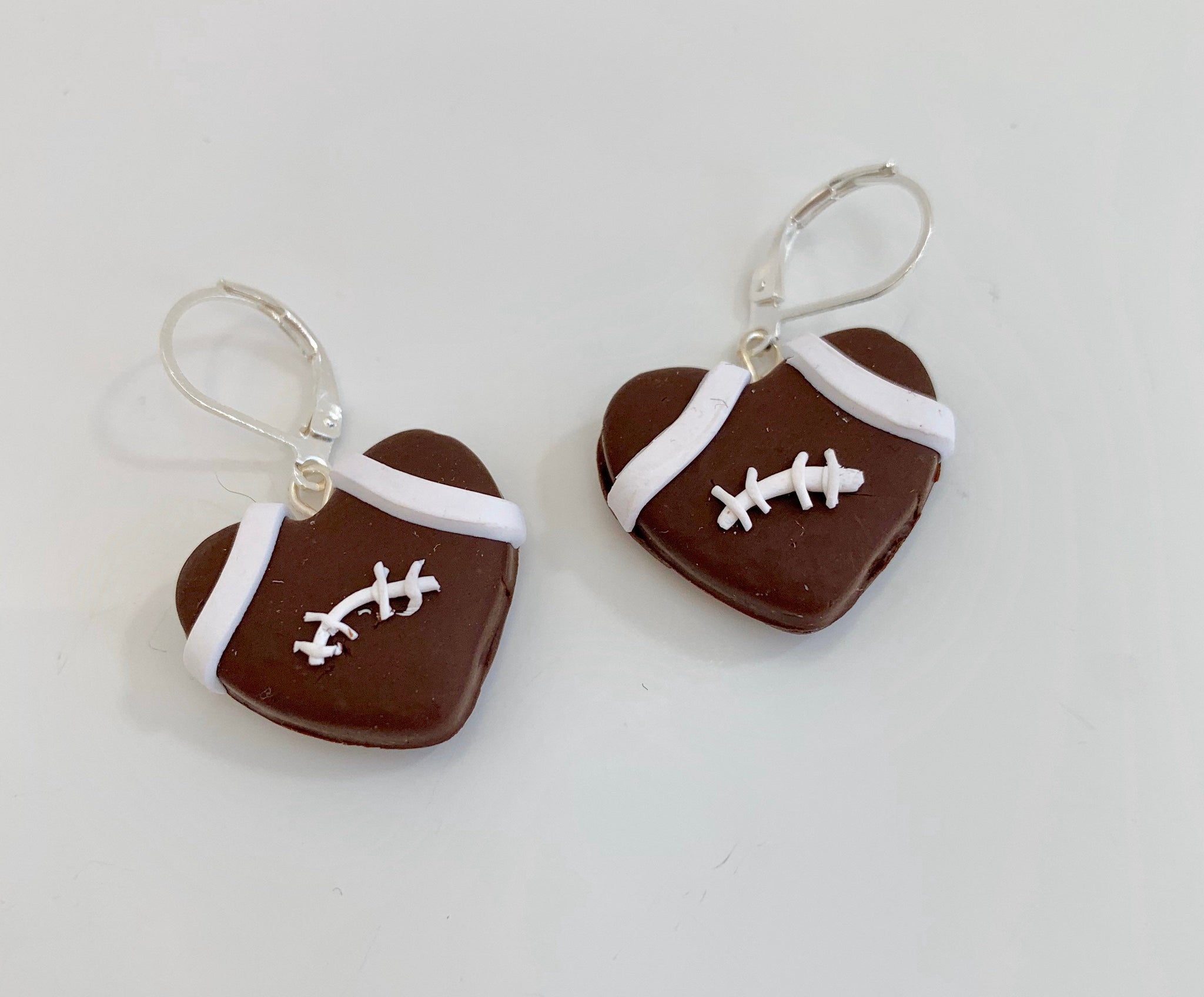 Football heart dangle earrings