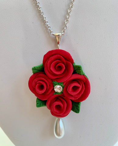 Red rose cluster with pearl necklace