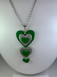Green and silver Celtic hearts necklace