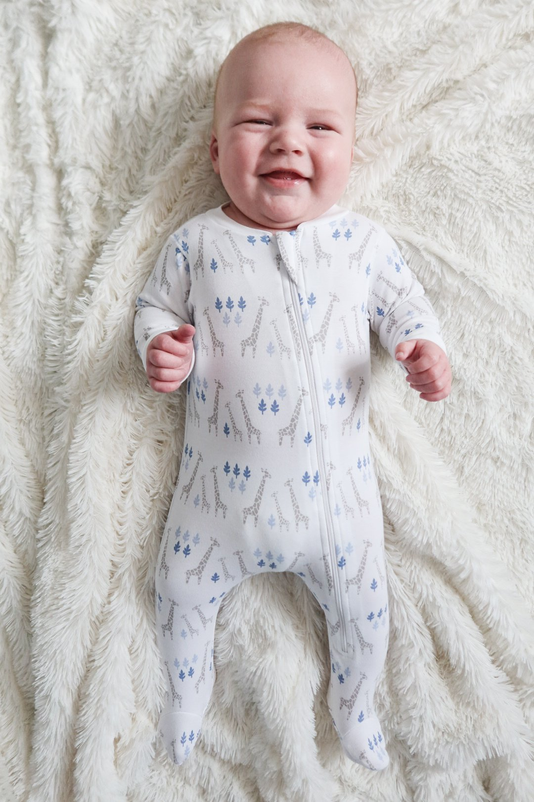 Feather Baby Giraffe on White Zip Footie