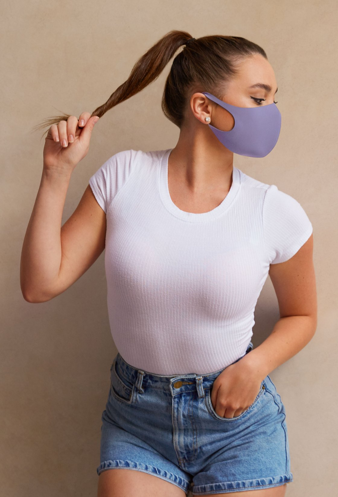 Woman wearing an EBY washable and breathable cloth mask in shadow color.