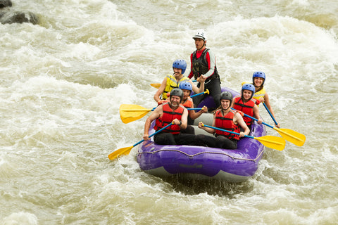 A family experiences adventure travel by going on a rafting trip together.