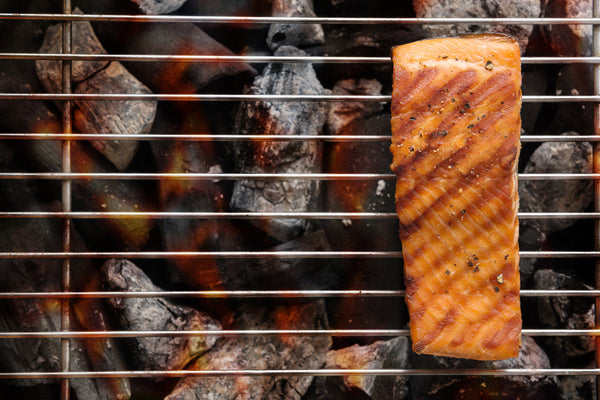 Salmon cooking over a grill.