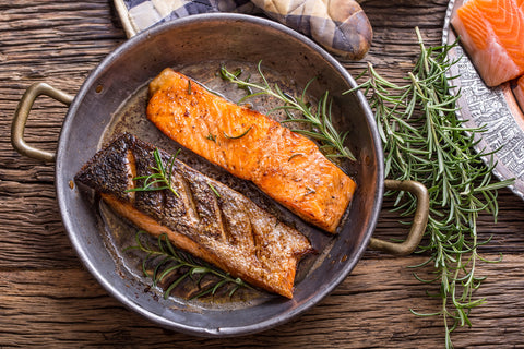 Salmon fillet in a pan on a picnic table
