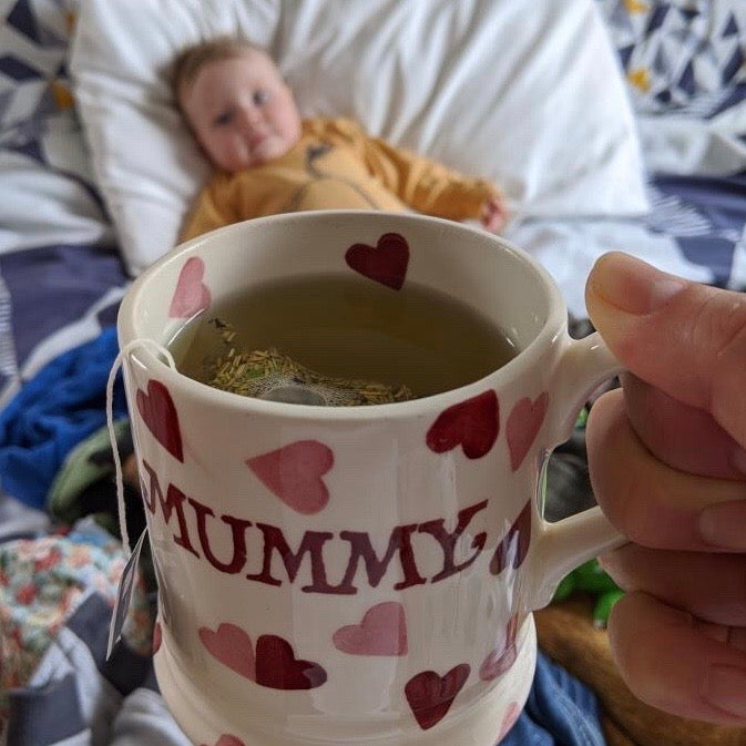 The Final Push Raspberry leaf tea in a mummy mug with newborn baby