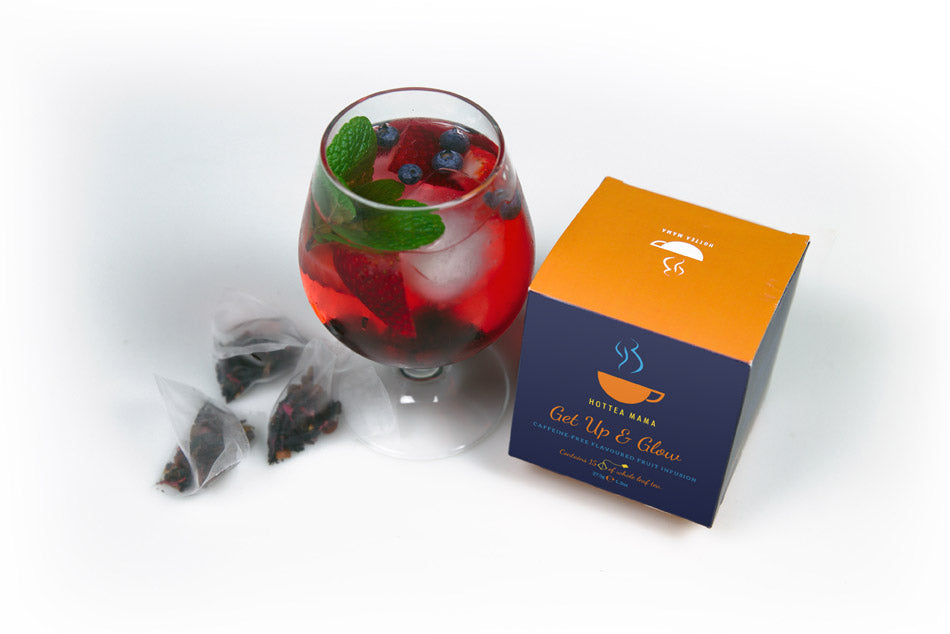 Get Up & Glow pack shot with iced tea brewed in a glass