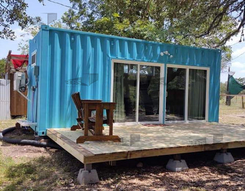 20' blue shipping container home with deck