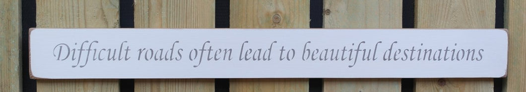 Shabby chic wooden sign  - Difficult roads often lead to beautiful destinations