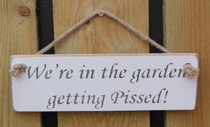 Shabby chic wooden sign We're in the garden getting pissed