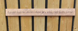 Handmade wooden sign A Mother holds her childrens hands for a while..