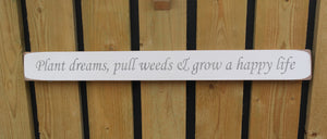 British handmade wooden sign Plant dreams pull weeds and grow a happy life