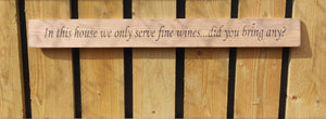 Handmade wooden sign In this house we serve fine wines Did you bring any?