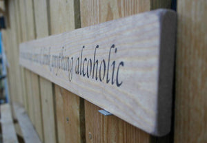 British handmade wooden sign In this house, We laugh, dance and drink anything alcoholic