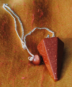 Goldstone faceted pendulum dowser on silver chain