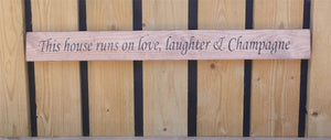 British handmade wooden sign This home runs on love, laughter and champagne