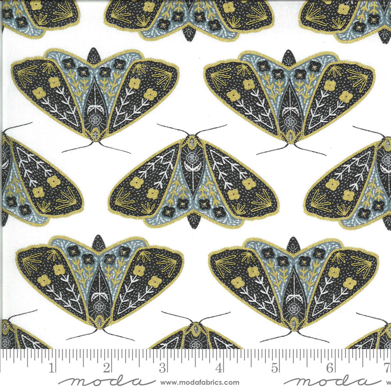 Gold, black, and blue moths on white