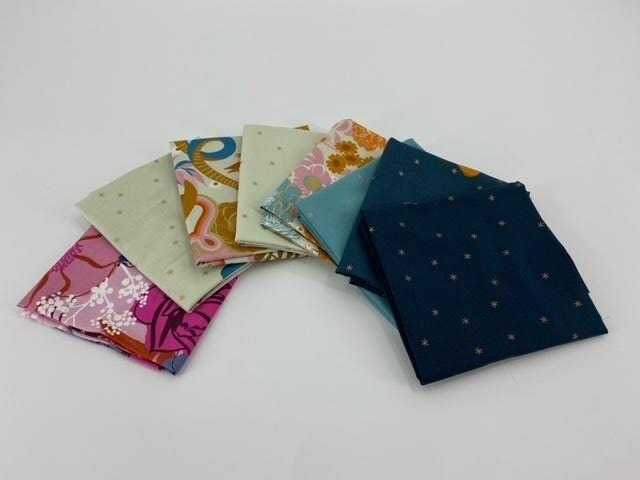 Fat quarter Bundle Rise. Quilting cotton is green, pink, and navy with stars and florals