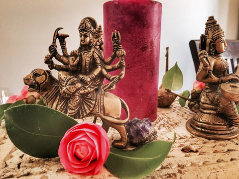 Yoga goddess altar, flowers, candle