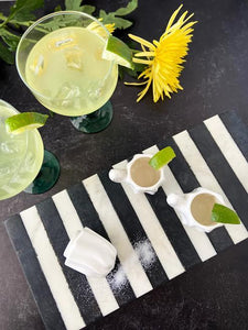 cactus margarita glasses and striped marble board