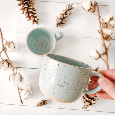 Handmade ceramic mug by Cath Ceramics in Toronto, Ontario. The mugs are robin egg blue with speckles.