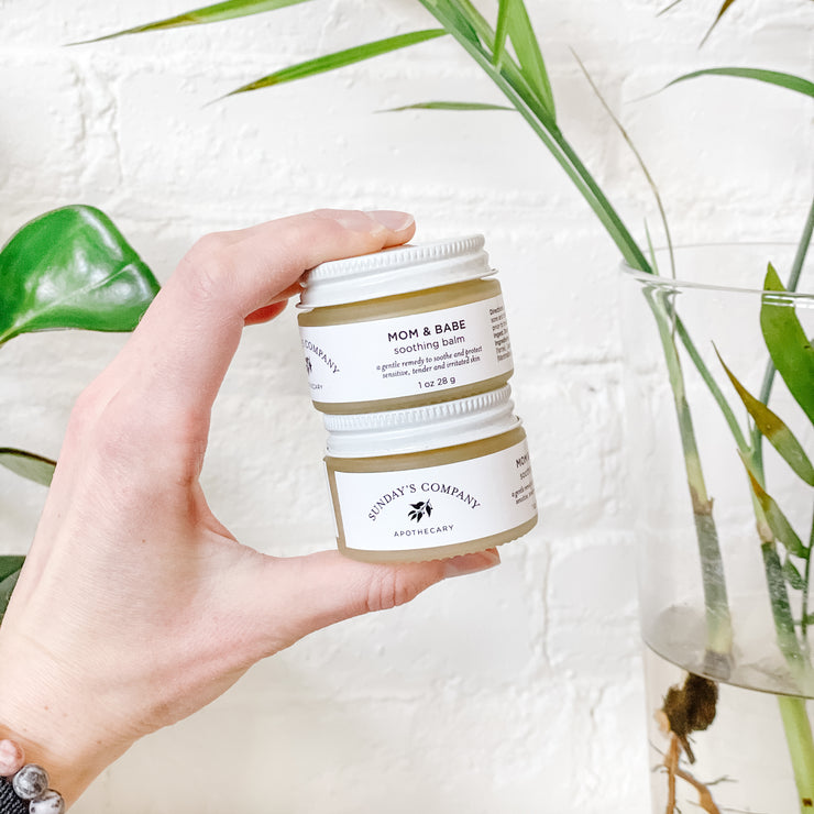 Mom & Babe Balm is a handcrafted, small-batch product from Sunday's Company, Prince Edward County, Ontario.  An unscented, gentle blend of soothing and anti-inflammatory plants treat and protect baby's skin, as well as tender, cracked, sore and chafed skin that often occurs with breastfeeding. No need to wipe off prior to breastfeeding.