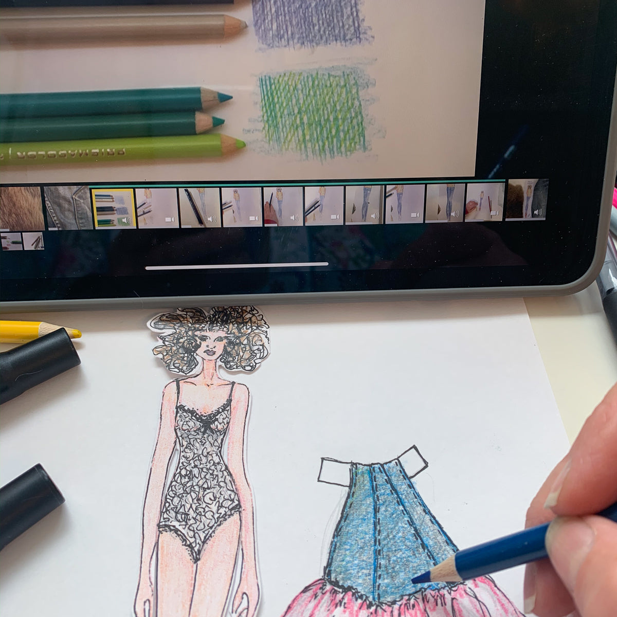 Hand sketching denim paper doll skirt with iPad showing sketching instructions