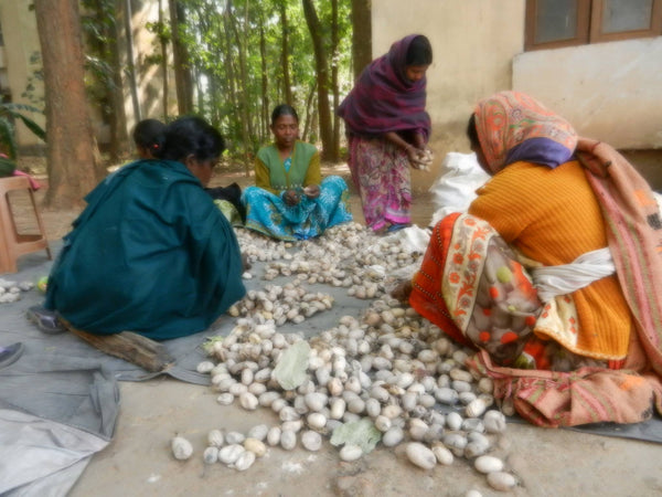Women sorting good quality cocoon and removing stalk from the cocoon at Nagri, Jharkhand