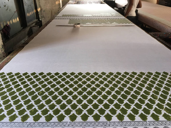 Preparing the table for hand block printing at DesiCrafts