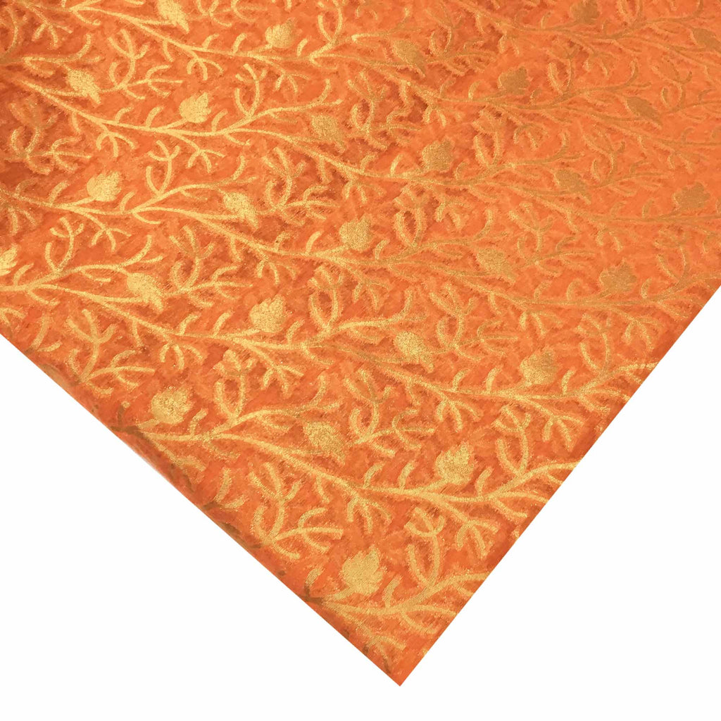 Coral and gold banarasi silk fabric