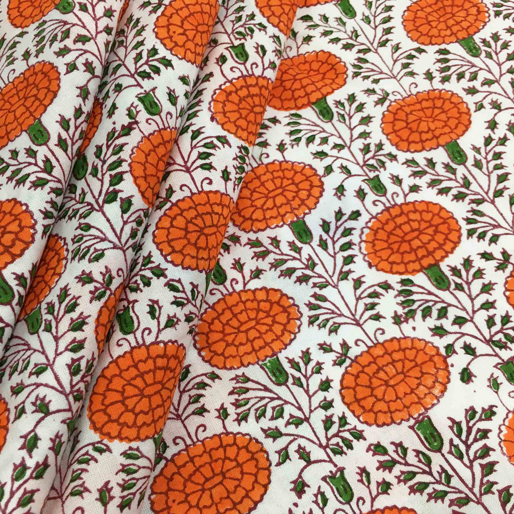 Orange marigold block print cotton fabric