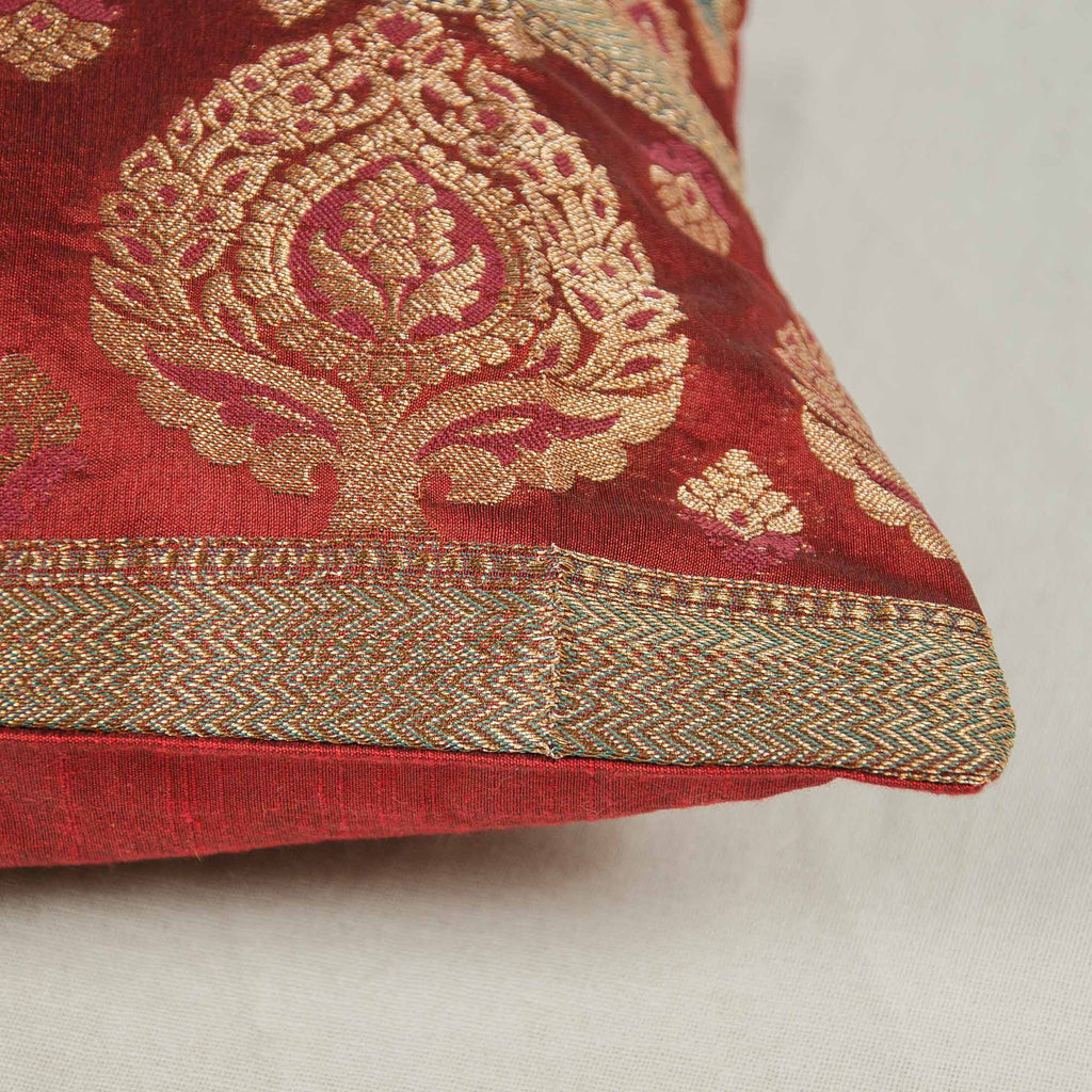 red and gold silk pillow